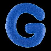 Letter G from felt on black background Stock Photos