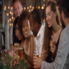Friends making a toast at a Christmas party in a bar Stock Footage