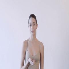 Beautiful caucasian woman blowing gold glitter confetti slow motion Stock Footage