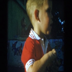 1962: little kid playing outside picking up small items and standing up looking Stock Footage
