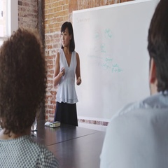 Businesswoman At Whiteboard Giving Presentation Shot On R3D Stock Footage