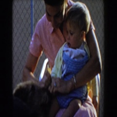 1962: i saw a lady with a baby play . GLENDALE, CALIFORNIA Stock Footage
