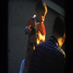 1962: father bouncing little boy on his shoulders. GLENDALE, CALIFORNIA Stock Footage