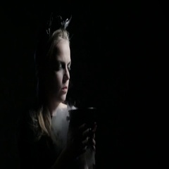 Dark portrait of evil witch with bowl. 4K UHD Stock Footage