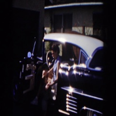 1962: mother and son getting out of a car. GLENDALE, CALIFORNIA Stock Footage