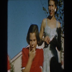 1962: boy concentrated on his toy being watched by a lady GLENDALE, CALIFORNIA Stock Footage