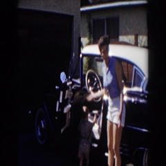 1962: a child sitting in the car waving with his mom out the door GLENDALE Stock Footage