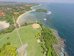 Aerial shot of the Nusa Dua peninsula island and pantai samuh beach Stock Footage