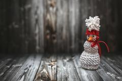 Christmas decoration in vintage toning on dark black wooden background with knit Kuvituskuvat