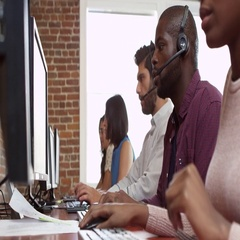 Staff At Desks In Customer Service Department Shot On R3D Stock Footage
