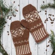 Brown warm Mittens on vintage wooden texture Stock Photos