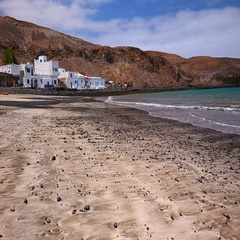 Fishing village Pozo Negro with stone and sand beach, Fuerteventura, Spain. Stock Footage