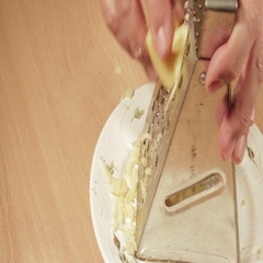 Grating cheese close up. Close up shot. Stock Footage