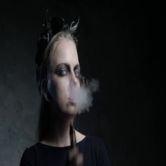 Dark portrait of evil witch with vaporizer. 4K UHD Stock Footage