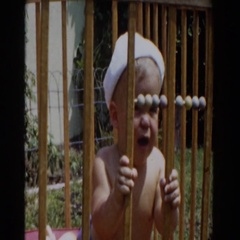 1962: baby crying in his crib GLENDALE, CALIFORNIA Stock Footage