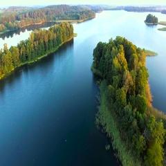 Green island in blue lake Stock Footage