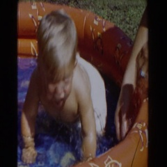 1962: baby pool splash! GLENDALE, CALIFORNIA Stock Footage