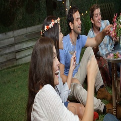Group Of Friends Enjoying Night Time Party In Garden Stock Footage