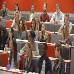 Teacher addressing students in a university lecture theatre Stock Footage