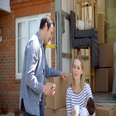 Portrait Of Family On Tail Lift Of Removal Truck Moving Home Stock Footage