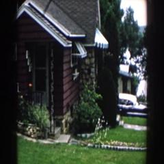 1960: facade of a small village house near the road BRIGHTON, MICHIGAN Stock Footage