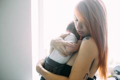 Young mother woman holding her child baby Stock Photos
