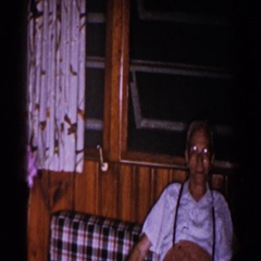 1960: grandpa and grandma stop and smell the flowers BRIGHTON, MICHIGAN Stock Footage
