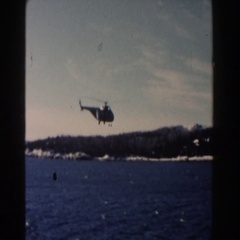 1960: helicopter low approach over water and island lighthouse scene DEARBORN Stock Footage