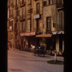 1960: horse driven cart travels down main street Stock Footage