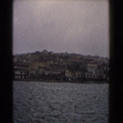 1960: panoramic of the seaside with city in the background. Stock Footage