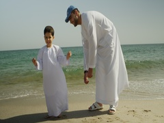 Father playing with son at the beach. Stock Footage