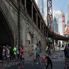New York City Marathon runners with the aerial tram above  Stock Footage
