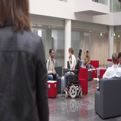 Low angle view of students in a busy university lobby area, shot on R3D Stock Footage