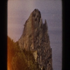 1960: a man picking up two women in joy while viewing a beautiful mountain Stock Footage
