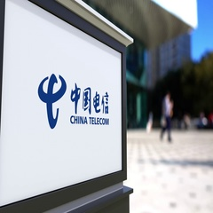 Street signage board with China Telecom logo. Blurred office center and walking Stock Footage