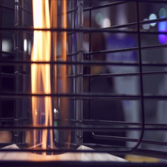Outdoor gas heater on the terrace of a cafe at night, blurred background Stock Footage