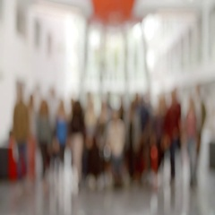 Large group of students move into focus in university lobby Stock Footage