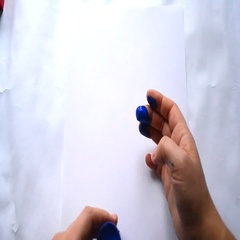 Girl hands paint blue paint on the white paper Stock Footage