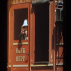 1961: little boy waving goodbye on a train. KNOTTS BERRY FARM, CALIFORNIA Arkistovideo