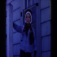 1961: child standing on porch DEARBORN, MICHIGAN Stock Footage