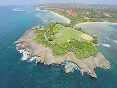 Aerial shot of the Nusa Dua peninsula island and pantai Nusa Dua Stock Footage
