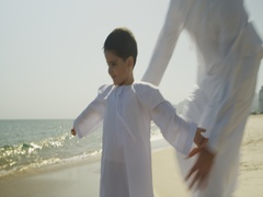 Father embracing son at the beach. Stock Footage