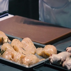 Chicken fillet in a restaurant kitchen preparing for roasting Stock Footage