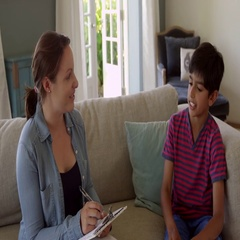 Young Boy With Problems Talking To Counselor Shot On R3D Stock Footage