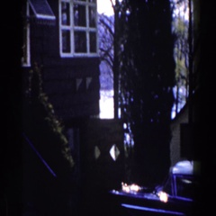 1959: house plot on the shore of a lake with vehicles parked in the yard Stock Footage