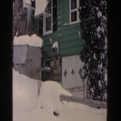 1961: a house and the roadways which are fully covered snow  Stock Footage