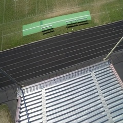 Overhead camera panning over seating and field of football stadium. COLORADO Stock Footage