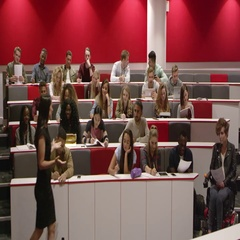 Female teacher presenting to students in a lecture theatre, shot on R3D Stock Footage