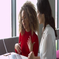 Female Student Works One To One With Tutor Shot On R3D Stock Footage