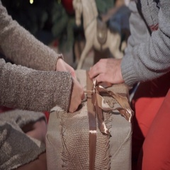 Hands of young couple wapring a xmas gift Stock Footage